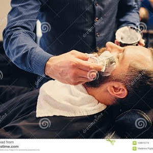 Barber applies shaving foam barber applies shaving foam to man s face saloon 109915774