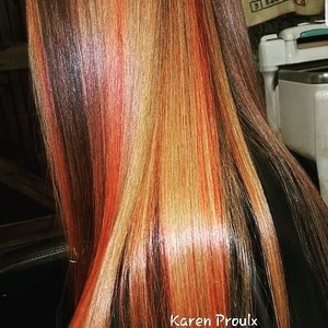 Red head with multi dimensional highlights