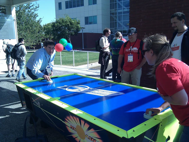 Googlers Playing Nok Hockey