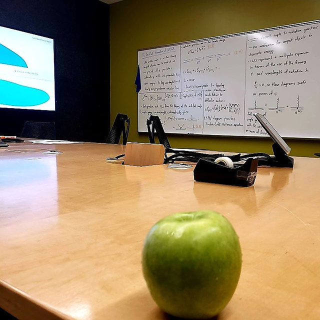 An Apple On A Conference Room Table At Google