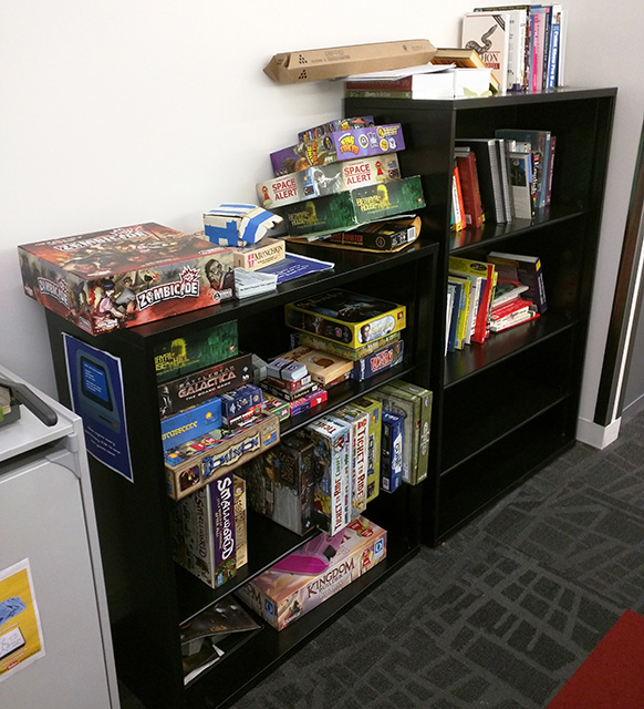 Googles Bookshelves Filled With Board Games