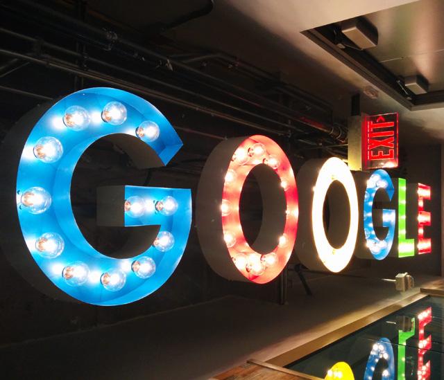 Google Light Bulb Logo Sign On Ceiling
