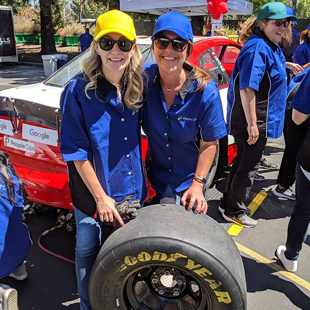 Googlers Training To Change Tires On Race Cars As Pit Crew