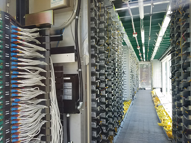 Google Server Room With Lots Of Servers & Wires