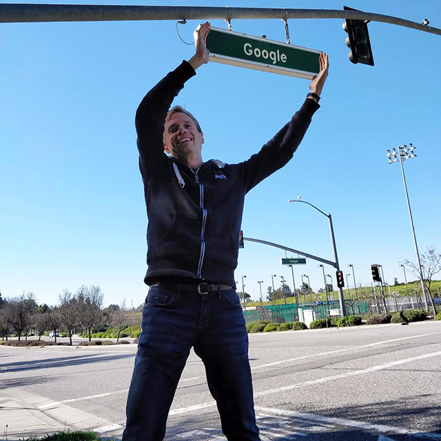 Holding The Google Street Sign
