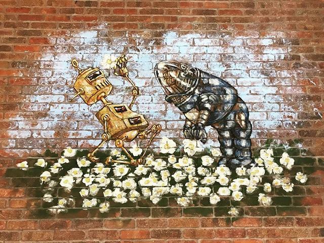 GoogleBot-kunst op bakstenen muur bij GooglePlex
