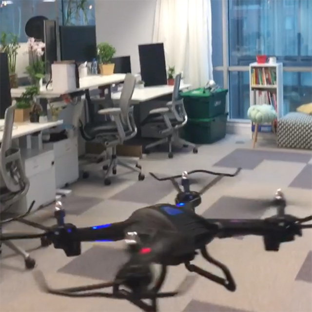Googlers Flying A Drone Indoors