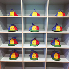 Many Noogler Hats On A Shelf