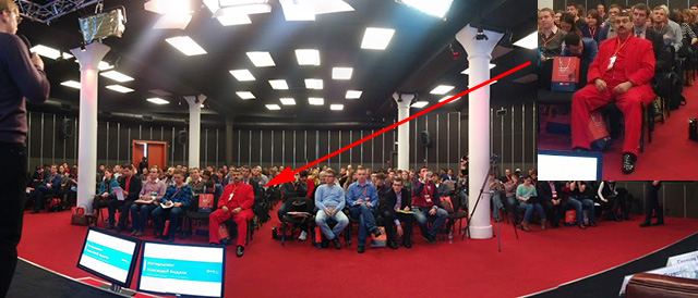 Man In Red Suit During SEO Panel