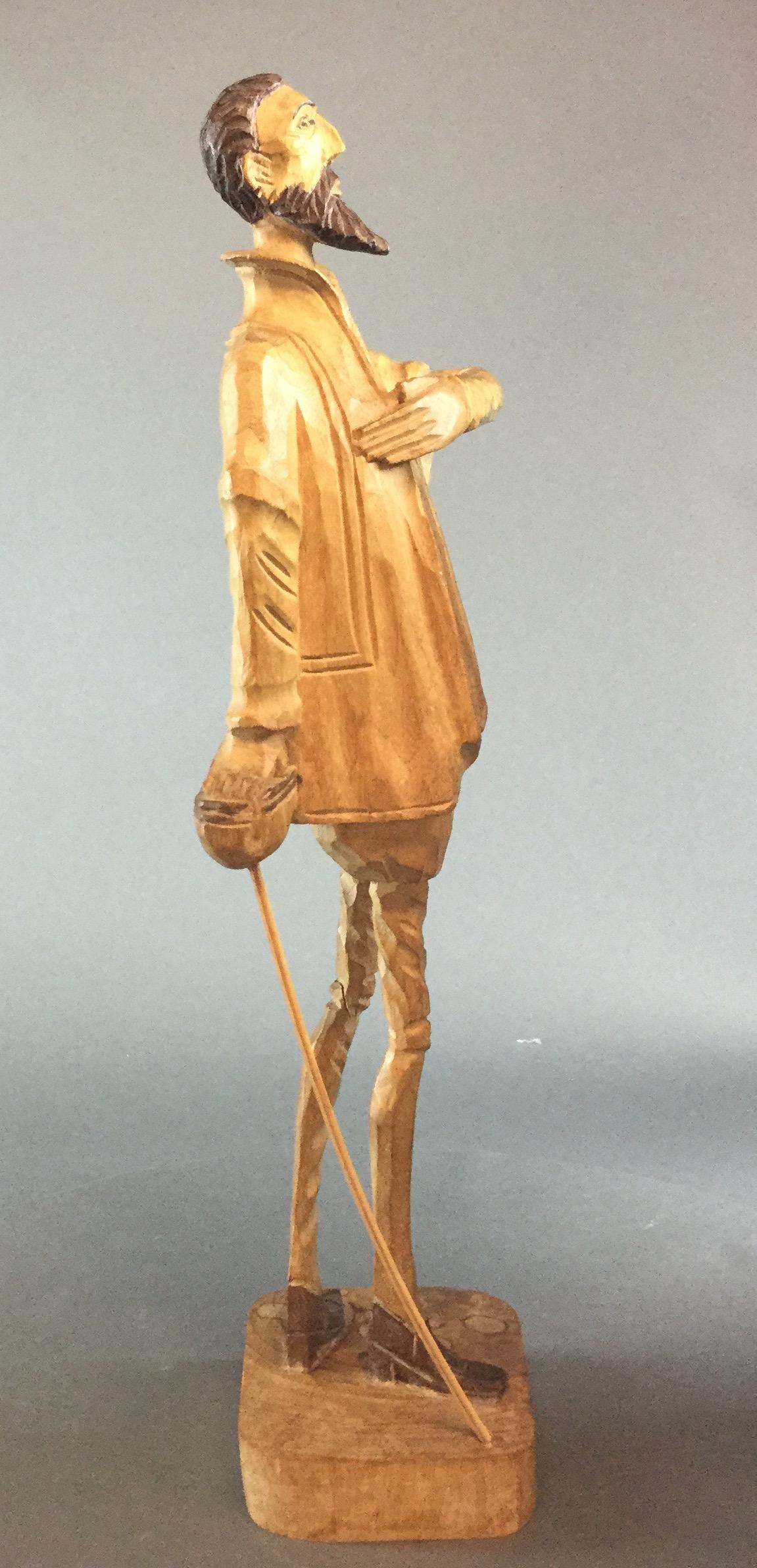Carved-Don-Quixote-Figurine_60596D.jpg