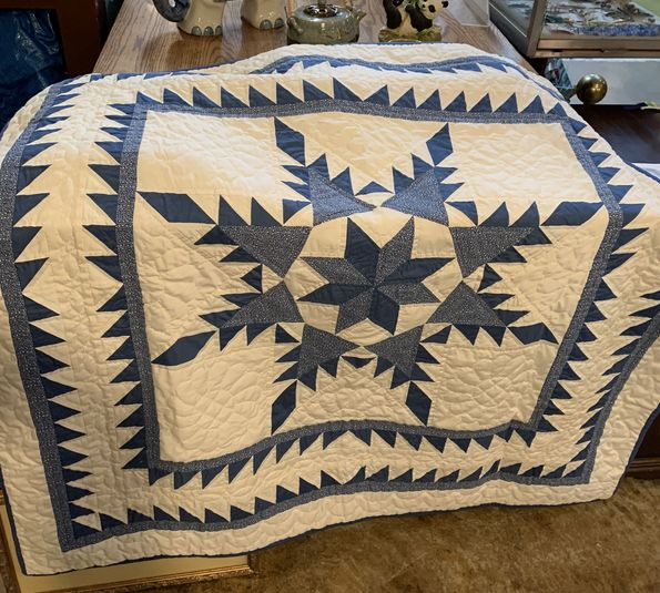 Blue-and-ecru-geometric-patterned-quilt-w-rod-pocket_148407A.jpg