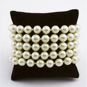 CHANEL Pearl five strand link bracelet with gold trim