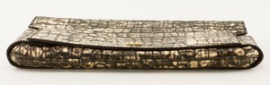 GIVENCHY-brown-and-cream-leather-stamped-crocodile-clutch_263791D.jpg