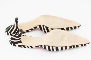 KATE-SPADE-Black-and-Cream-Animal-Print-Pointed-Toe-Pumps_286846H.jpg