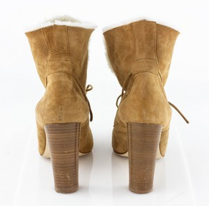MANOLO-BLAHNIK-Tan-Shearling-Heeled-Boots_294901F.jpg
