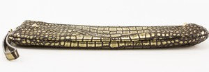 STUART-WEITZMAN-gold-and-black-mock-crocidile-clutch_268227C.jpg