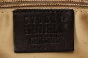 STUART-WEITZMAN-gold-and-black-mock-crocidile-clutch_268227H.jpg