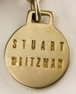 STUART-WEITZMAN-gold-and-black-mock-crocidile-clutch_268227I.jpg