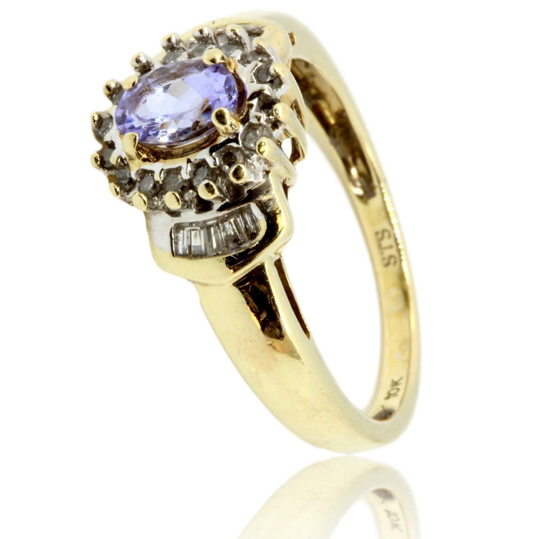 14K-Gold-.44ct-Tanzanite--.23ctw-Diamond-Ring_87160A.jpg