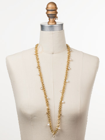 Aura Long Strand Necklace in Bright Gold-tone Modern Pearl displayed on a necklace bust