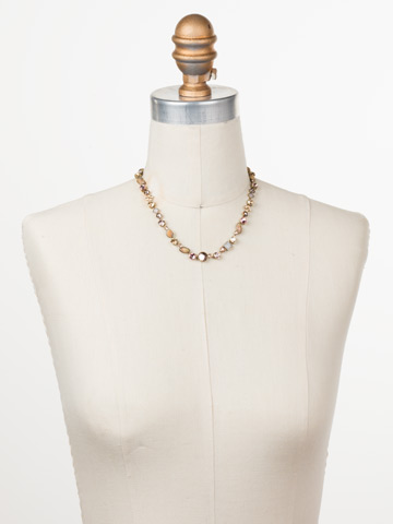 Classic Tee-Shirt Necklace in Antique Gold-tone Beach Comber displayed on a necklace bust