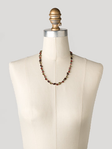 Classic Tee-Shirt Necklace in Antique Gold-tone Go Garnet displayed on a necklace bust