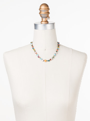 Classic Tee-Shirt Necklace in Antique Gold-tone Happy Birthday displayed on a necklace bust