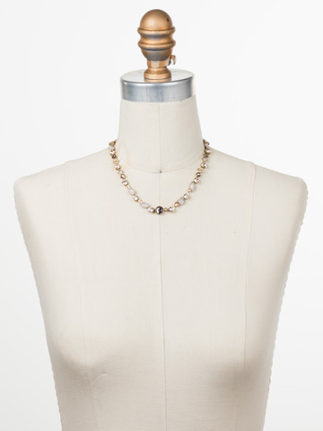 Classic Tee-Shirt Necklace in Antique Gold-tone Satin Blush displayed on a necklace bust