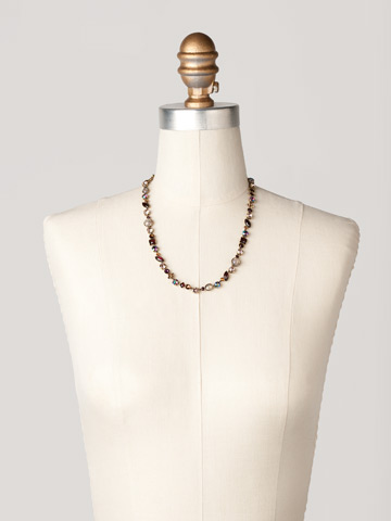 Classic Tee-Shirt Necklace in Antique Gold-tone Sundance displayed on a necklace bust