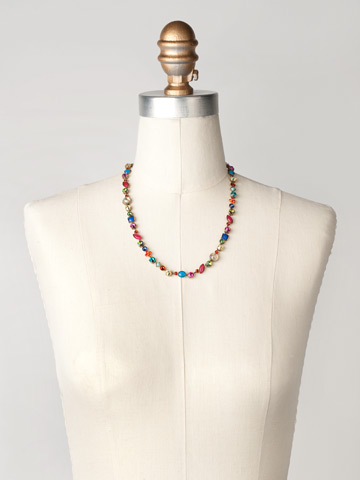 Classic Tee-Shirt Necklace in Antique Gold-tone Southwest Brights displayed on a necklace bust