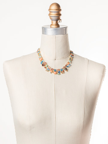Colette Necklace in Bright Gold-tone Mango Tango displayed on a necklace bust