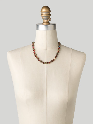 Classic Crystal Floral Necklace in Antique Gold-tone Go Garnet displayed on a necklace bust