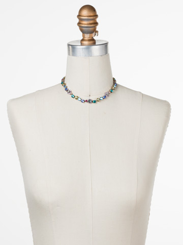 Classic Crystal Floral Necklace in Antique Gold-tone Wildflower displayed on a necklace bust