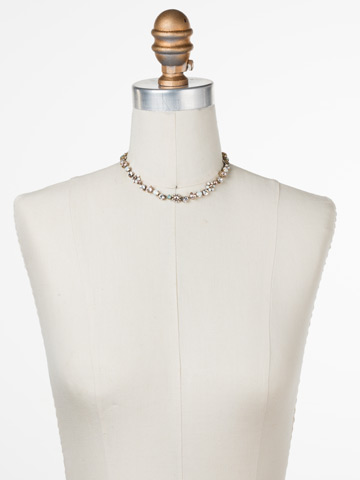 Classic Crystal Floral Necklace in Antique Gold-tone White Magnolia displayed on a necklace bust