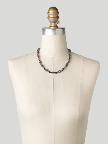 Classic Crystal Floral Necklace in Antique Silver-tone Battle Blue displayed on a necklace bust