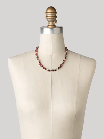 Classic Crystal Floral Necklace in Antique Silver-tone Crimson Pride displayed on a necklace bust