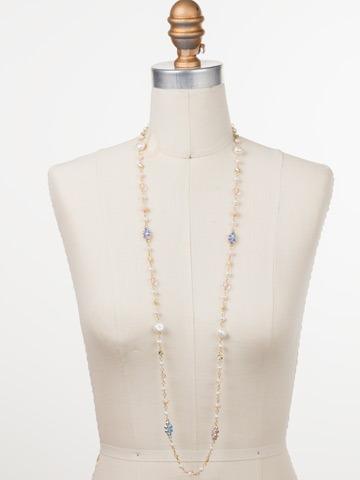 Lilliana Long Strand Necklace in Bright Gold-tone Silky Clouds displayed on a necklace bust