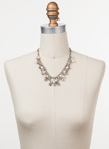 Clustered Crystal and Bead Necklace in Antique Silver-tone Soft Petal displayed on a necklace bust