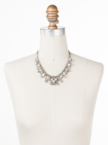 Clustered Crystal and Bead Necklace in Antique Silver-tone Snow Bunny displayed on a necklace bust