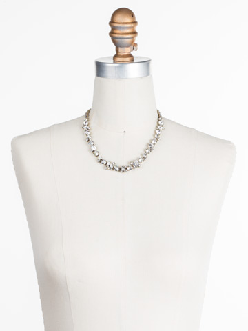 Glittering Multi-Cut Crystal Necklace in Antique Gold-tone Crystal displayed on a necklace bust