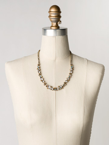 Glittering Multi-Cut Crystal Necklace in Antique Gold-tone Neutral Territory displayed on a necklace bust