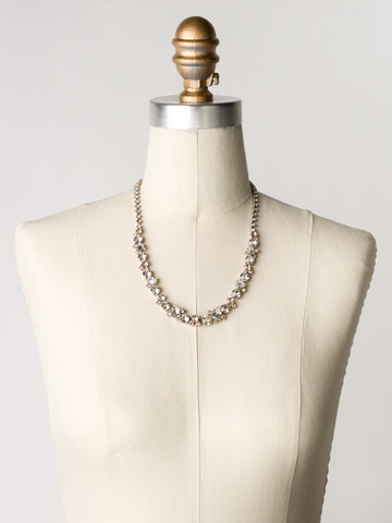 Glittering Multi-Cut Crystal Necklace in Antique Silver-tone Crystal Clear displayed on a necklace bust