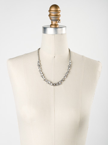 Glittering Multi-Cut Crystal Necklace in Antique Silver-tone Crystal displayed on a necklace bust