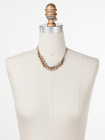 Modern Crystal Line Necklace in Antique Gold-tone Raw Sugar displayed on a necklace bust