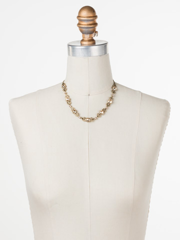 Crystal Petal Necklace in Antique Gold-tone Raw Sugar displayed on a necklace bust