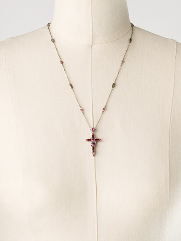 Delicate Cross Pendant Necklace in Antique Silver-tone Pink Ruby displayed on a necklace bust