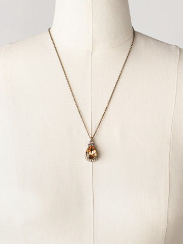 Sweet Sparkle Necklace in Antique Gold-tone Amaretto displayed on a necklace bust
