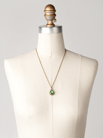 Sweet Sparkle Necklace in Antique Gold-tone Green Apple displayed on a necklace bust