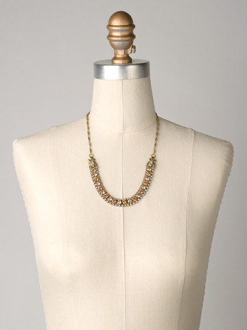 Right on Track Necklace in Antique Gold-tone Desert Sun displayed on a necklace bust