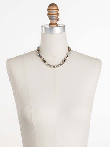 Heather Necklace in Antique Gold-tone Washed Waterfront displayed on a necklace bust